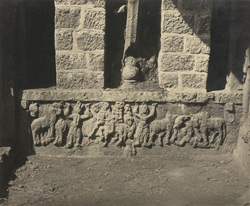 Close view of sculpture on left end of verandah of the small Buddhist Vihara, Bhaja Caves